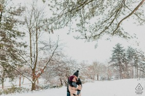 Paris winter couple portrait session under the winter trees and the snow covered ground