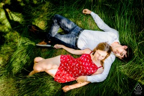 Montpellier couple portrait laying in the grass and shot from above