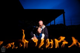 MN night brewery pre wedding portrait session with a Couple by the fire at a local brewery