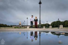 Paris pre wedding reflection portrait in the streets using a large puddle