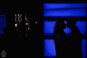 London, UK couple portrait with blue video screen backdrop