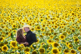 Cheyenne, Wyoming couple portrait in a field of sunflowers taken from a ladder