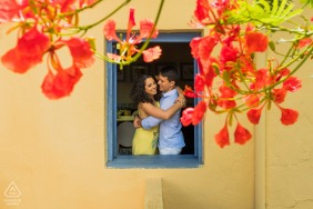 Maceió framed portrait of couple smiling out a window in Brazil