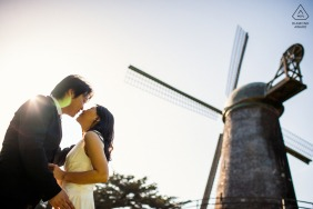 San Francisco windmill couple portrait while they kiss