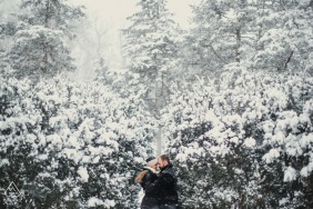 Peoria winter pre wedding couple portrait in a snow-packed engagement session