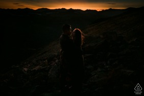 Rocky Mountain National Park, CO outdoor mountain photo session before the wedding day with some Cuddling in the last seconds of sunlight