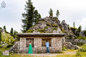 Dolomites, Italy outdoor mountain photo session before the wedding day with some Looks of love before the stone building