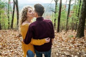 Georgia couple engagement pic session at Smithgall Woods Helen with a kiss on top of the mountain