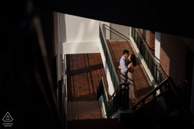 Hong Kong couple engagement pic session with a tender Kiss shot from above indoors