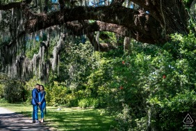 Magnolia Plantation and Gardens pre - wed image in Charleston, SC with The couple standing underneath a beautiful tree in the Magnolia Gardens