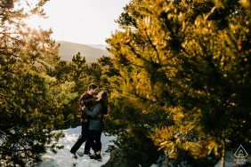 CO engaged picture session at the Golden Gate Canyon State Park with the Couple hugging each other in the trees