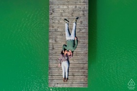 Arroyo Frío couple engagement pic session at Hotel Noguera de la Sierpe using an overhead drone craft above the dock in Jaén