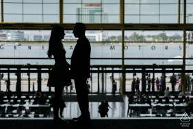 Detroit pre - wed image at General Motors with a silhouette by the water