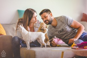 Palermo couple pre-wed portrait at home on the couch with two small dogs