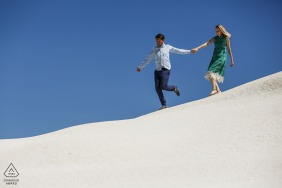 Cappadocia couple pre-wed portrait while walking in the white sands of Turkey