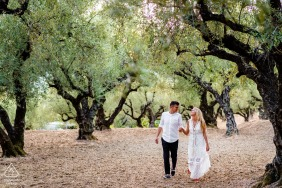 Zakynthos engaged couple picture session in Greece while Walking into the olive fields