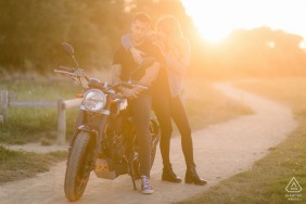 Vendee engaged picture session at Les Sables d'Olonne with a Sunset shot of a couple and their motorcycle