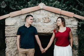 Peyriac-de-Mer couple engagement pic session in a small village with a center framed symmetrical pose