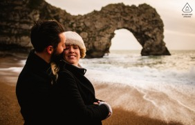 Dorset couple pre-wed portrait at the waters edge with the gigantic natural arch