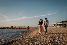 Portonovo engaged couple picture session with a carefree walk by the waters edge