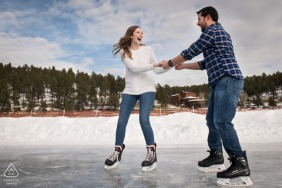 Evergreen, Colorado engaged couple Ice-skating photo on the largest Zamboni-maintained outdoor ice rink in North America