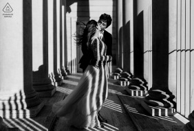 San Francisco, CA Artful Engagement Picture in the building columns and stripes of light and shadows