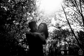 The National Arboretum Pre Wedding Photoshoot in a Fine Art Style in DC as the The couple is having fun in front of a forest of cherry trees