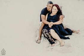 Noordhoek, Cape Town Fine Art Pre Wedding Portrait with contrasting colours of the black attire on the white sand of this engaged couple