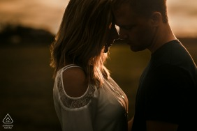 Peoria, IL Fine Art Engagement Session for a young couple leaning into each other during sunset
