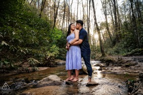 Pigeon Forge, TN Fine Art Engagement Session as The couple stands barefooted in the middle of a running creek in the smoky mountains