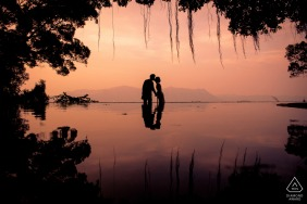 Hong Kong Fine Art Pre Wedding Portrait at sunset by the water with a Kiss