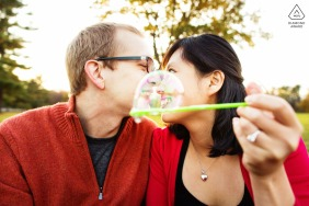 New Jersey Artful engagement session with bubbles and red tops