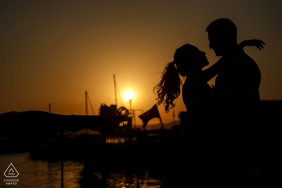 Urla Fine Art Engagement Session in Izmir, Turkey at sunset by the boats on the water