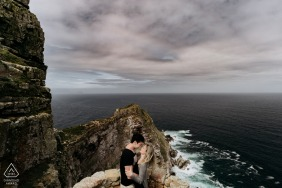 Cape Town Fine Art Engagement Image for a couple high above the sea on the rocks and cliffs