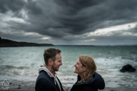 Planguenoual, France Fine Art Pre Wedding Portrait low framed couple at the beach with clouds