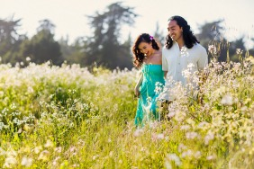 Santa Cruz Artful Engagement Photography showing Lovers walking through a flower field on a warm, lovely day in Spring