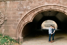 Central Park, New York City on-location portrait e-shoot of couple framed under the opening of an overpass