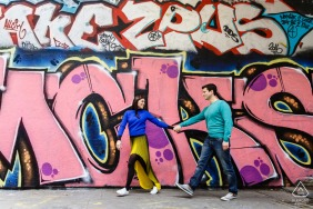 London on-location portrait e-shoot in the back streets with graffiti painted wall