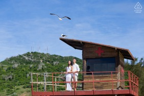 Arraial do Cabo, RJ on-location portrait e-shoot on a lifeguard tower with seagulls
