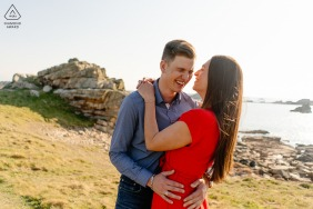 Ploumanach on-location portrait e-shoot of newly engaged couple having fun by the sea