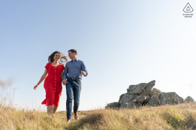 Trevou Treguignec on-location portrait e-shoot of couple running in the open field