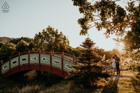 Halsweh Quarry Park Christchurch  on-location portrait e-shoot of a couple kissing at sunset by a bridge