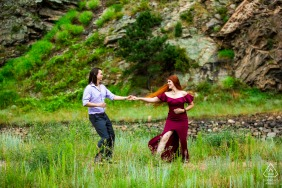 Clear Creek, Golden, Colorado portrait e-session of couple swing dancing out in a field