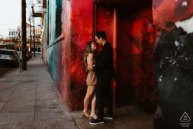Los Angeles environmental engagement e-session of couple getting cozy in the Arts District