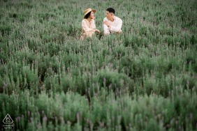 Dalat portrait e-session of a couple sitting in a field