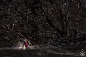 Hacienda La Central, Cartago, CR environmental engagement e-session of a couple standing in front of a burned forest in the skirt of the Turrialba Volcano