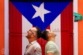 Old San Juan portrait e-session with a happy vibe in this photo with a flag as background