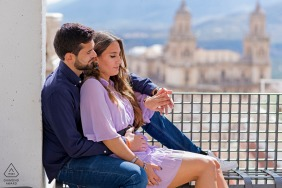 Jaén, Spain environmental engagement e-session with a couple relaxing in a soft embrace above the city