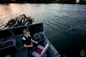 Minneapolis, MN on-location portrait e-shoot with the Couple on a boat with their kid fishing