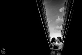 Brno environmental engagement e-session for a Couple kissing under the narrow strip of the sky